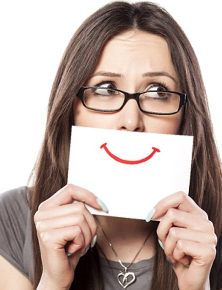 A woman holding a fake smile over her own