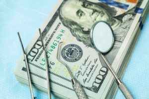 money and dental instruments
